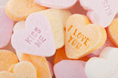 Love you and kiss me candy hearts — Stock Photo