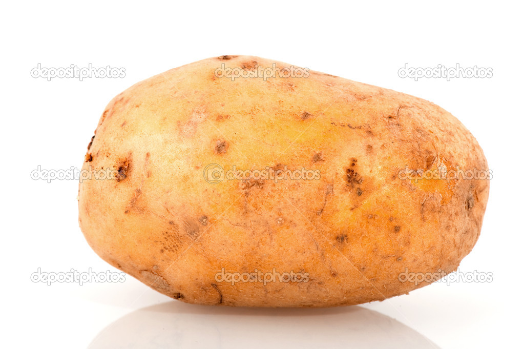 One single potato raw and isolated over white  Stock Photo #2445085