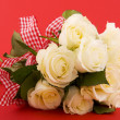 White roses on red — Stock Photo