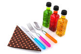 Salad dressing and silverware — Stock Photo