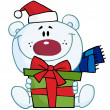 Christmas Polar Bear Holding A Gift - Stock Photo