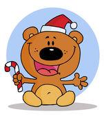 Glad jul nalle som håller en sockertopp — Stockfoto