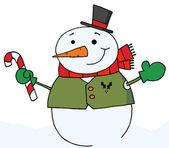 снеговик, держа конфета — Стоковое фото