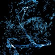 Stock Photo: Blue water on black background