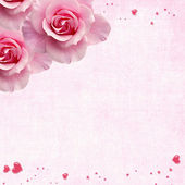 Pink roses with jewelled hearts — Stock Photo