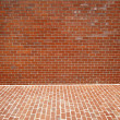 Stock Photo: brick wall and sidewalk