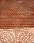 Brick wall and sidewalk — Stock Photo