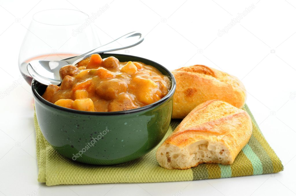 Bowl of hearty homemade beef stew with crusty bread. — Stock Photo #2388366