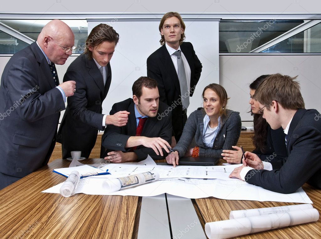 A company manager, and his team, discussing plans in a modern  office — Stock Photo #2237102