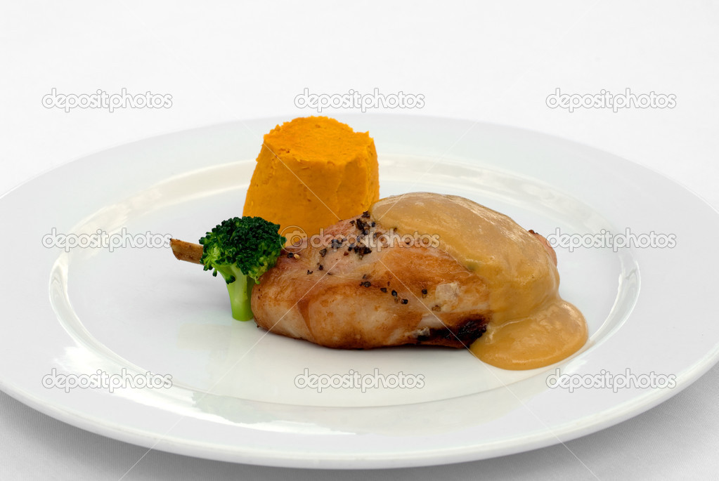 Pork Loin, served with a Roasted Pumpkin Timbale and Piquant Honey Sauce — Stock Photo #2239932