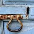 Blue door with rusty knocker — Stock Photo