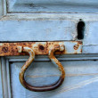 Stock Photo: Blue door with rusty knocker