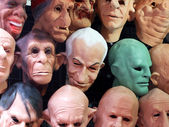 Display of human and animal masks — Stock Photo