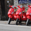 Stock Photo: Three red scooters in Tuscany