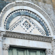 Tympanum above church door in Volterra — Stock Photo