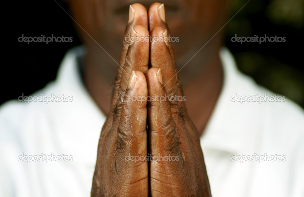 Fingers of afro man in prayer shot closeup — Stock Photo #2178187