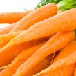 Stock Photo: Bunch of Baby Carrots over white