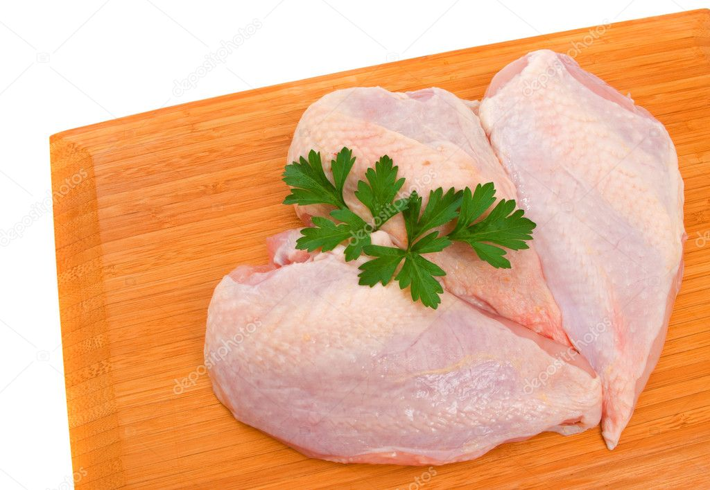 Three chicken breast fillets on wooden chopping board isolated over white background. — Stock Photo #2258999