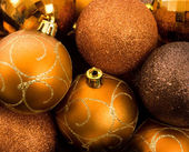 Gold Christmas Baubles in feather nest — Stock Photo