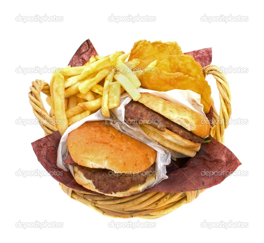 Basket filled with hamburgers, fries and potato cakes on white background  Stock Photo #2462004