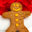 Gingerbread Man and Santa Hat - Stock Photo