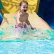 The littel girl plays in water — Stock Photo