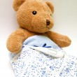 Stock Photo: Teddy bear with thermometer