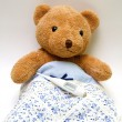 Teddy bear with a thermometer — Stock Photo