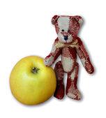 Teddy bear and an apple — Stock Photo