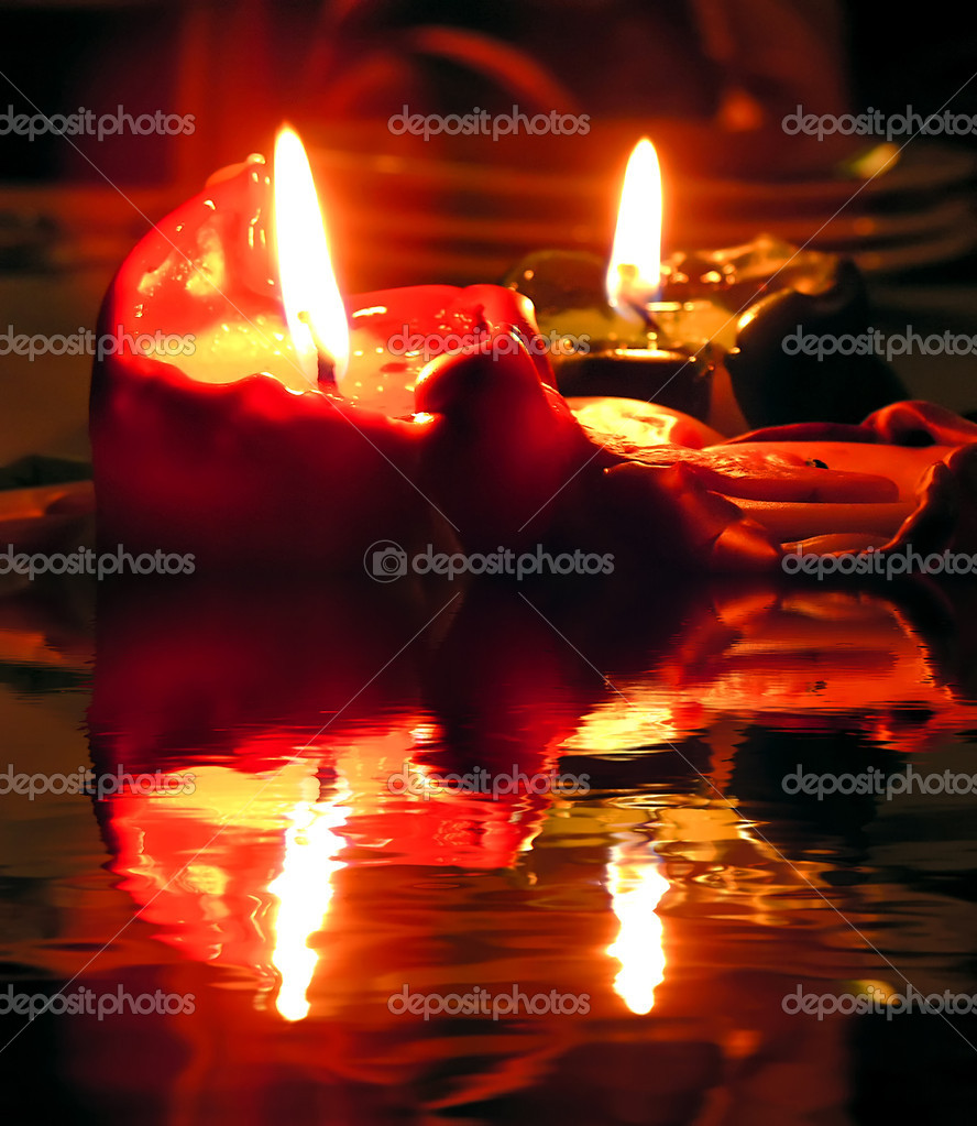 Burning candles and their reflection on water  Stock Photo #2270095