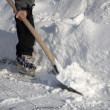 Man working with snow shovel - Stock Photo