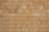 Wall of ochre bricks — Stock Photo