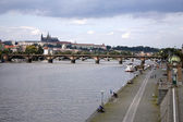 Prague castle and vltava riverbank — Stock Photo