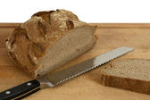 Sliced bread and knife — Stock Photo