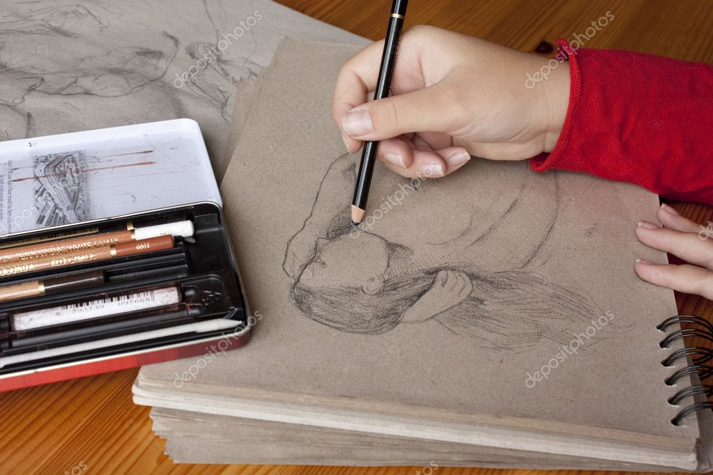 Illustrator at work - using ink pen and paper — Stock Photo #2230593