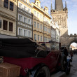 Veteran car and tower in Prague — Stock Photo