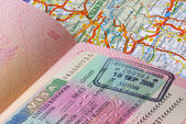 Passport and a road map — Stock Photo