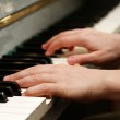 Hands playing piano — Stock Photo