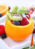 Orange filled with fruits — Stock Photo