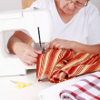 Elderly womsewing — Stock Photo #2232105