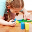 Adorable girl playing with blocks — Stock Photo #2232237