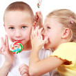 Kids whispering - Stock Photo