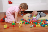 Adorable kids playing with blocks — Stock Photo