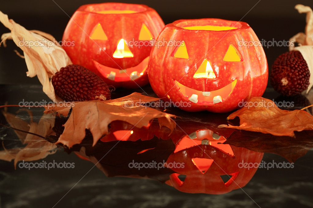 Halloween candle-light with leaves on black background  Stock Photo #2231213