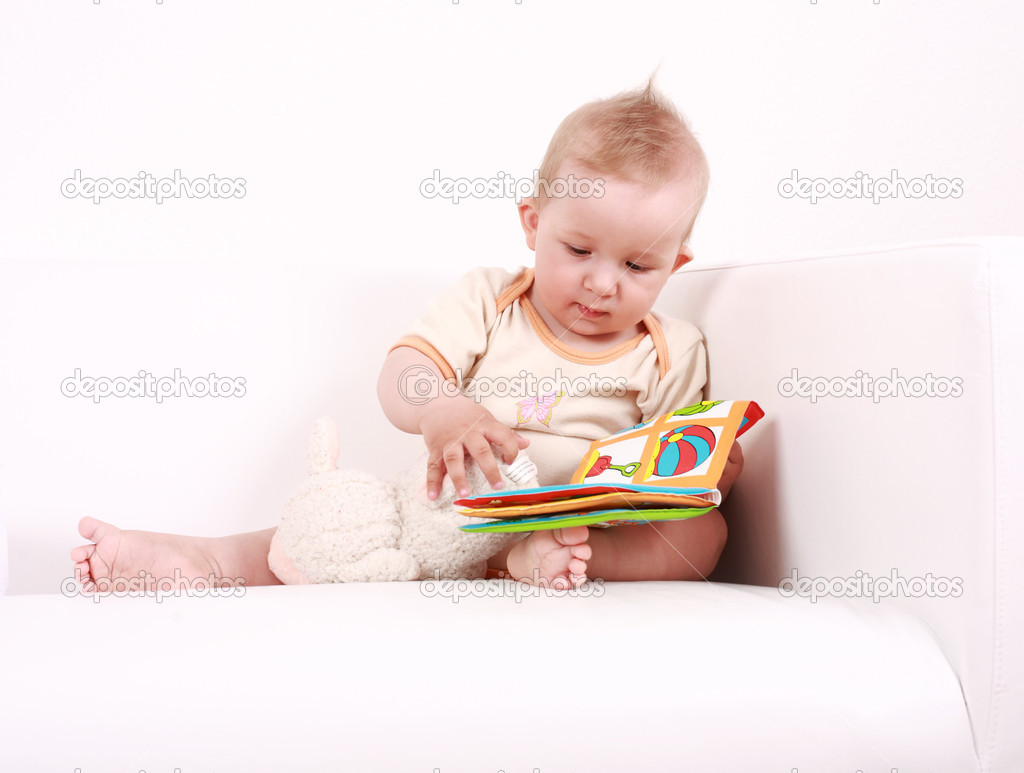 Portrait of cute baby reading a picture book — Stock Photo #2232290