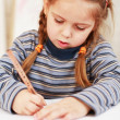 Cute little girl painting at home — Stok fotoğraf