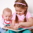 Adorable kids reading and playing — Foto Stock