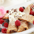 Crepes filled with chocolate and fruits — Stock Photo