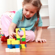 Stock Photo: Adorable girl playing with blocks