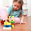 Foto Stock: Adorable girl playing with blocks